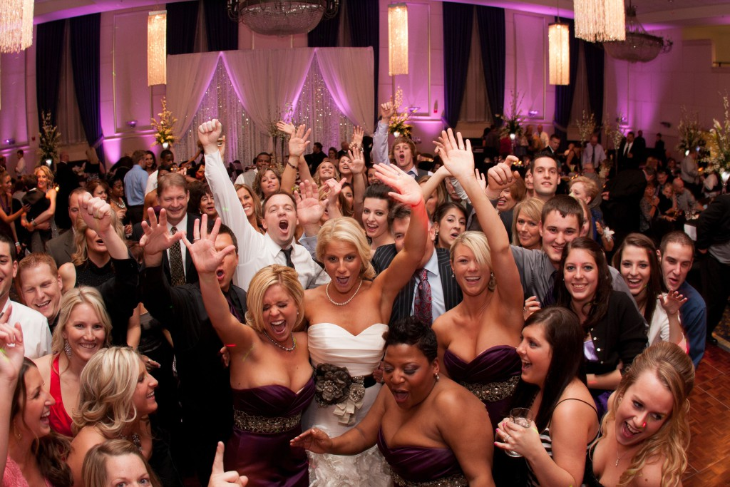 Bride-Bridesmaids-and-Wedding-Guests-Having-Fun-Together-in-Wedding-Party